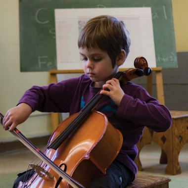 Child playing Suzuki cello